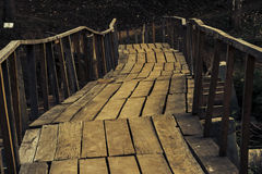 Old wooden bridge with handrails Stock Images