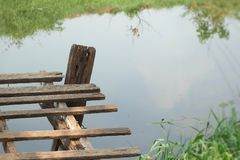 Old wooden bridge on the lake Stock Image