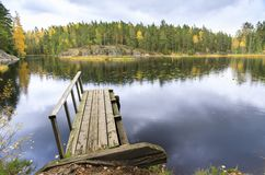 Old wooden bridge in a lake in autumn Stock Image