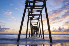Old wooden bridge in Natai beach with beautiful sky at twilight Royalty Free Stock Photos