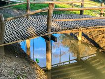Old wooden bridge at noon. In the park royalty free stock photo