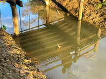 Old wooden bridge at noon. In the park Stock Photography
