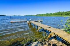Old wooden bridge on Norwegian lake Stock Photography