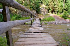 Old wooden bridge over Aries River Royalty Free Stock Image