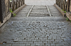 An old wooden bridge over the moat. Of the fortress Royalty Free Stock Photos