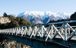 Old wooden bridge over mountain river Stock Images