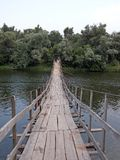 Old wooden bridge over river Royalty Free Stock Images