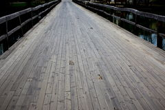 Old wooden bridge. Over the river royalty free stock photography