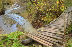 Old wooden bridge over river Stock Photos