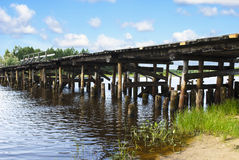Old wooden bridge over the  river, Russia Royalty Free Stock Images