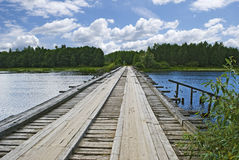 Old wooden bridge over the river, Russia Stock Photos