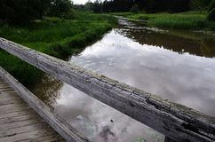 Old wooden bridge over the river Royalty Free Stock Photo
