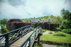 Old wooden bridge. Over the River to the House stock photography