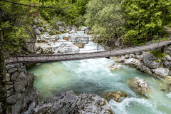 Old wooden bridge over Soca river Royalty Free Stock Photography