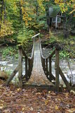 Old Wooden Bridge over stream Stock Photo