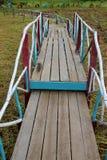 Old wooden bridge over wetland Stock Images