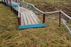 Old wooden bridge over wetland Stock Photos
