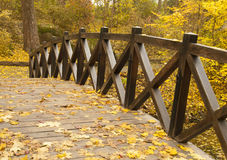 Old wooden bridge. In an old park in autumn Royalty Free Stock Photography