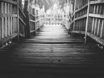 Old wooden bridge path, black and white. Old wooden bridge path across the lake/river to dead end,  selective focus, black and white Stock Images