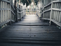 Old wooden bridge path to dead end Stock Image