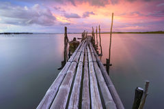 Old wooden bridge Phuket at sunset . Thailand Stock Images