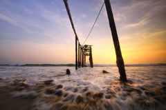 Old wooden bridge Phuket at sunset . Thailand Stock Photos
