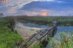The old wooden bridge on river Stock Image