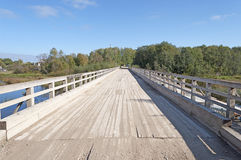 Old wooden bridge in the rural countryside Stock Photo