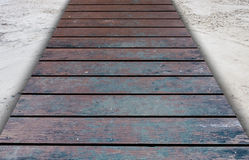 Old wooden bridge on the sand Stock Image