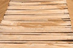 Old wooden bridge on the sandy shore Stock Photo