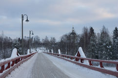 Old wooden bridge of Skelleftea. The Lejonstromsbron wooden bridge of the Swedish town of Skelleftea in a early winter morning Stock Photos