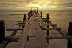 The old wooden bridge sunset. Royalty Free Stock Photo