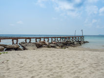 Old wooden Bridge to the blue sea Royalty Free Stock Photo