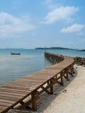 Old wooden Bridge to the blue sea. At Koh Kood, Trat, Thailand Royalty Free Stock Photos