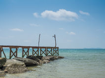 Old wooden Bridge to the blue sea Stock Images