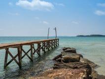 Old wooden Bridge to the blue sea Stock Photos