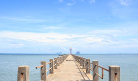 Old wooden bridge to dock pier in tranquil sea dream destination Royalty Free Stock Images