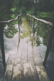 Old wooden bridge under water. Royalty Free Stock Photo
