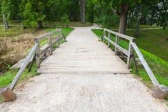 Old wooden bridge and walking lane in park Stock Image