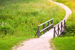 Old wooden bridge and walking lane Royalty Free Stock Photo