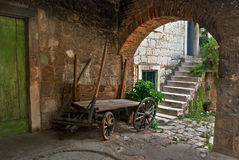Old wooden and broken handcart. Laying useless as decoration. Old town in Split, Croatia Royalty Free Stock Photos