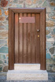 Old wooden brown door close up. Royalty Free Stock Photography