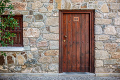Old wooden brown door close up. Royalty Free Stock Photo