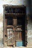 Old wooden brown door in ruin Royalty Free Stock Photo