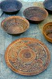 Old wooden brown plates with a pattern on the table stock photo