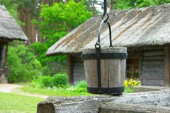 Old wooden bucket. Old village Royalty Free Stock Image