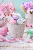 Old wooden bucket with easter eggs and feathers Royalty Free Stock Photo