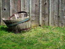 Old wooden bucket in grass Royalty Free Stock Image