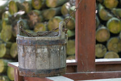 Old wooden bucket and well Royalty Free Stock Photos