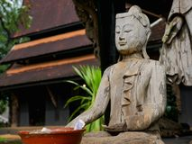 Old Wooden buddha statue. Old ancient Wooden buddha statue in Temple Royalty Free Stock Photos